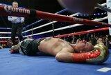 Lenkas po nokauto išgabentas į ligoninę, D.Wilderis apgynė pasaulio sunkiasvorių bokso čempiono titulą