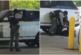 Pasirodė įrašas iš NFL čempiono suėmimo: policininkas išsitraukė ginklą