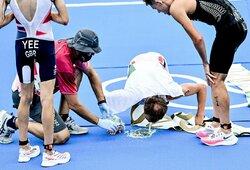 Olimpinis triatlonas visiškai išsunkė čempiono jėgas: K.Blummenfeltas apsivėmė ir buvo pasodintas į vežimėlį