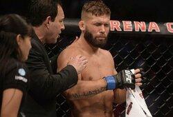 Nusivylimas Meksikoje: vos po 15sekundžių dėl dūrio į akį sustabdyta UFC pagrindinė vakaro kova, sirgaliai kovotojus apmėtė šiukšlėmis