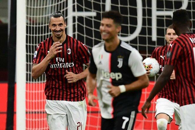 Zlatanas Ibrahimovičius ir Cristiano Ronaldo | Scanpix nuotr.