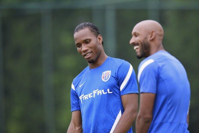 Didieras Drogba (kairėje) ir Nicolasas Anelka (kairėje)   AFP/Scanpix nuotr.