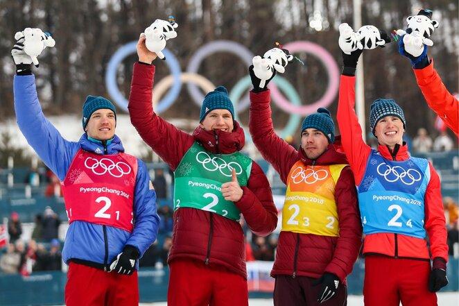 Vyrų slidinėjimo estafetės 4x10 km akimirka | Scanpix nuotr.